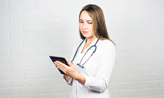 stina healthcare solutions portrait of a nurse using a digital tablet